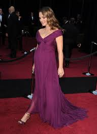 Natalie Portman shows off her bump in style.